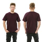 Man posing with blank dark purple shirt. Photo of a man wearing blank navy blue t-shirt, front and back. Ready for your design or artwork royalty free stock image