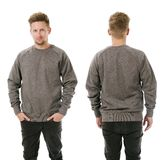 Man posing with blank grey sweatshirt. Photo of a man wearing blank grey sweatshirt, front and back. Ready for your design or artwork Royalty Free Stock Photography