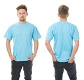 Man posing with blank light blue shirt Stock Images