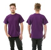 Man posing with blank purple shirt Royalty Free Stock Photo