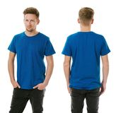 Man posing with blank royal blue shirt Royalty Free Stock Images