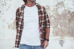 Man posing in blank white tshirt against street wal Royalty Free Stock Photos