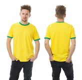Man posing with blank yellow and green shirt Royalty Free Stock Photography