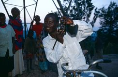 A man posing with a camera in Rwanda. Royalty Free Stock Photos