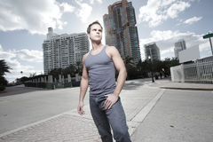 Man posing in the city Stock Images