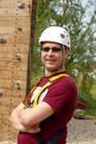Man is posing before climbing wall Royalty Free Stock Photo