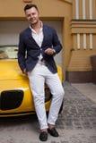 Man posing with convertible sportcar Stock Photo