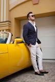 Man posing with convertible sportcar Stock Photos