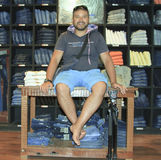 Man posing in denim jeans shop Royalty Free Stock Photos