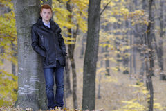 Man posing in fall season. Lonely young business man suffering in forests , fall season Royalty Free Stock Photo