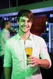 Man posing with glass of beer Stock Image