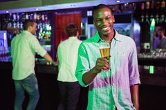 Man posing with glass of beer Stock Photography