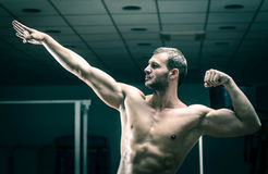 Man posing in gym. Young adult man posing in gym Royalty Free Stock Photos