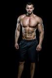 Man posing in gym Stock Images