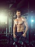 Man posing in gym Stock Image