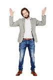 man posing with hands up on white background. human emotion expression and lifestyle concept. image on a white studio background. stock photo