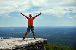 A man posing happy on the rock at Minnewaska State Park. Reserve Upstate NY during summer time Royalty Free Stock Photos