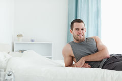 Man posing on his bed Royalty Free Stock Images