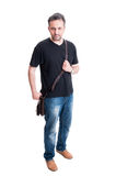 Man posing with jeans, black t-shirt and leather bag Royalty Free Stock Images