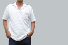 Man posing in jeans and polo shirt Stock Photo