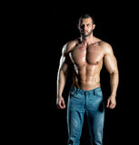 Man posing in jeans Royalty Free Stock Image