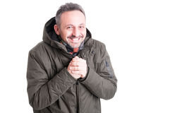 Man posing like being cold wearing winter casual clothes Royalty Free Stock Photos