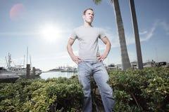 Man posing by the marina Stock Photos