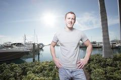 Man posing by the marina Royalty Free Stock Image