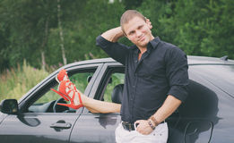 Man posing near the car. Stock Photo