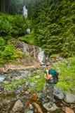 Man posing near waterfall Stock Photography