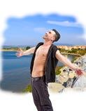 Man posing outdoor in summer sun light Royalty Free Stock Photo