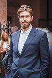 Man posing outside Byblos fashion shows building for Milan Women's Fashion Week 2014 Royalty Free Stock Image