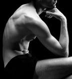 Man posing - part. Man posing on black bakground Stock Images