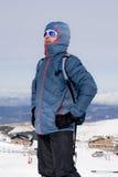 Man posing after peak summit trekking achievement in snow mountain on winter landscape Stock Photos
