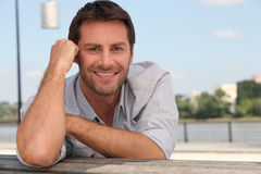 Man posing on a quay Royalty Free Stock Photography