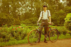 Man posing with retro bicycle in the park Stock Photo