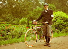 Man posing with retro bicycle in the park. Vintage style Royalty Free Stock Photos