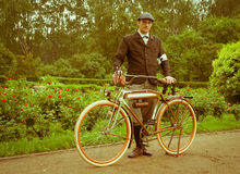 Man posing with retro bicycle in the park Stock Photography