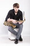 man posing with saxophone Stock Images