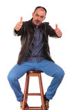 Man posing seated with legs wide open Stock Images