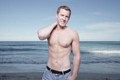 Man posing by the shore Stock Photos