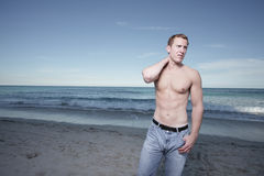 Man posing by the shore Royalty Free Stock Image