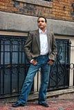 Man posing on sidewalk Royalty Free Stock Photos