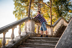 Man posing on stairs n forest Royalty Free Stock Photo