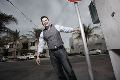 Man posing by a stop sign Stock Photography