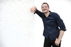 Man posing on the wall Stock Photography