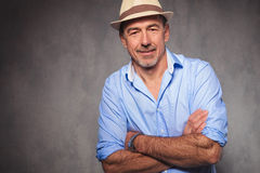 Man posing wearing a hat while looking at the camera with hands Royalty Free Stock Photo