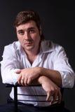 Man posing in white shirt on dark background Royalty Free Stock Image