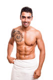 Man posing with a white towel. Attractive man posing with a white towel Royalty Free Stock Images