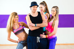 Man posing with woman in dance school Royalty Free Stock Images